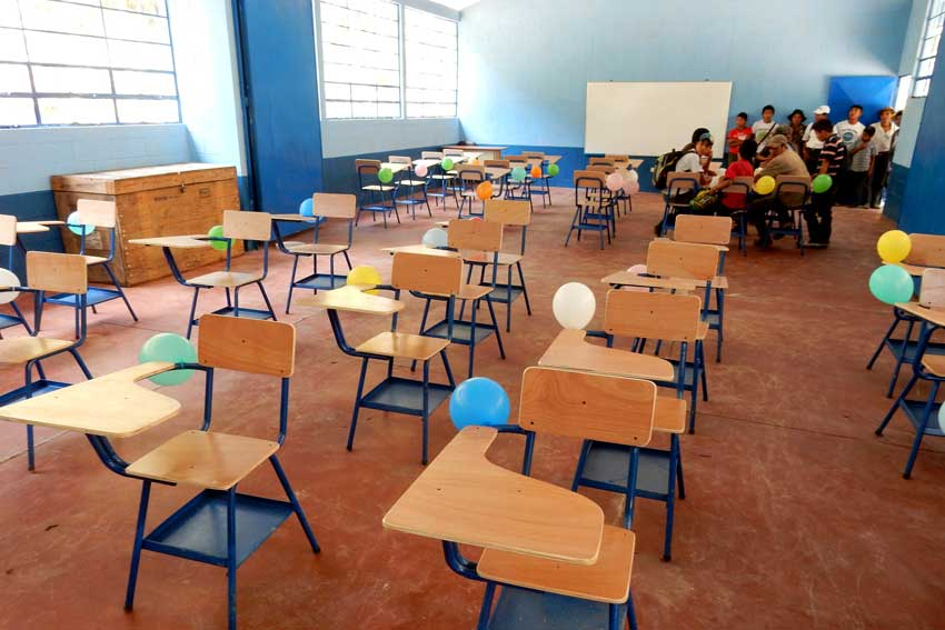 United by Friendship education project's school classroom with chairs and students.
