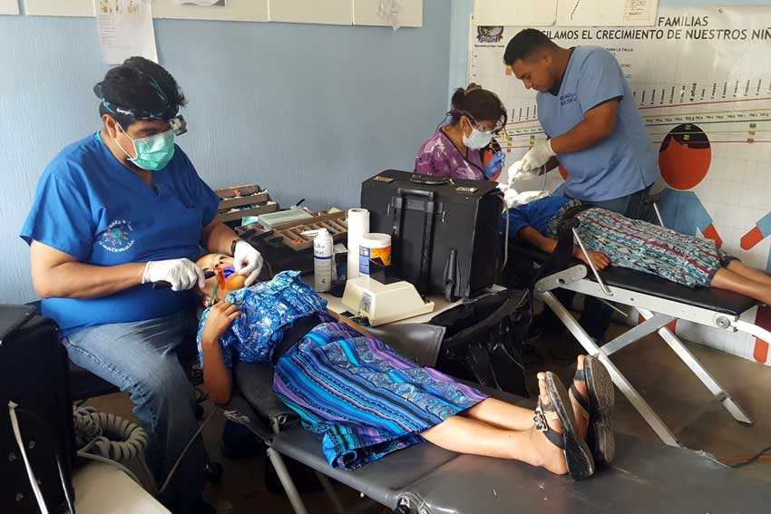 United by Friendship dental care project clinic with patients.