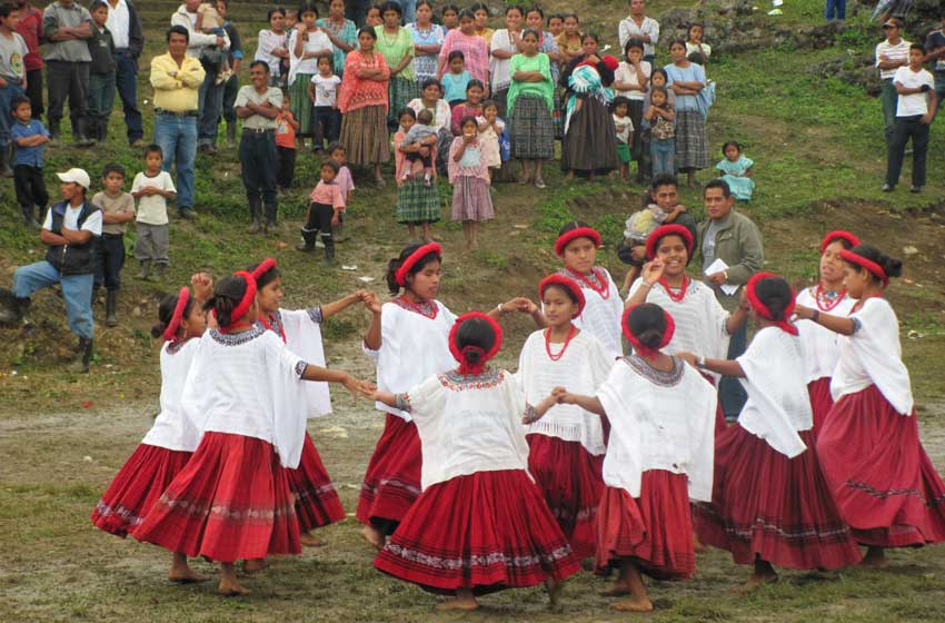 Community festival with dancing children.